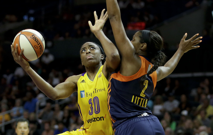 Los Angeles Sparks forward Nneka Ogwumike, left, shoots over Connecticut Sun forward Camille Little during the second half of an WNBA basketball game in Los Angeles, Sunday, June 26, 2016. (AP Photo/Chris Carlson)